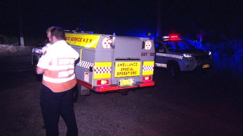 Ambulance officers and police made their way to the bottom of the cliff where they found the body. (9NEWS)
