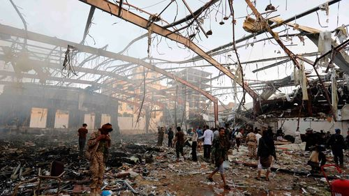 People inspect the aftermath of a Saudi-led coalition airstrike in Sanaa, Yemen. (AP)