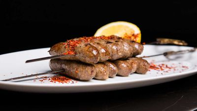 """Recipe: <a href=""""https://kitchen.nine.com.au/2017/11/17/14/41/skewered-lebanese-style-lamb-sausages-with-turkish-chilli-flakes"""" target=""""_top"""" draggable=""""false"""">Greg Malouf's Lebanese sausage</a>"""