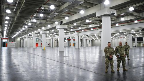 U.S. National Guard members stand at the Jacob Javits Center, in New York.