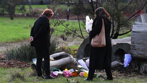 Mourners are seen at a makeshift memorial for Ms Herron.