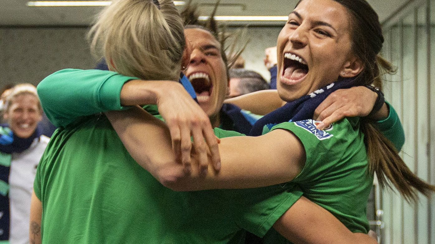 Australian soccer players Steph Catley, Alanna Kennedy and Lydia Williams react as FIFA announced Australia as the hosts to the 2023 FIFA Women's World Cup.