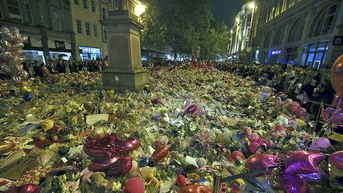 People pay their respects for the victims of the Manchester bombing during a vigil at 10.31pm in St Ann's Square in Manchester, Britain, 29 May 2017. (AAP)