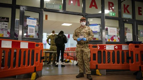 Troopers from The King's Royal Hussars, who normally crew main battle tanks, conduct coronavirus (Covid-19) Flow tests on members of the public at a testing centre set up at St John's Market Hall on November 07, 2020 in Liverpool, England