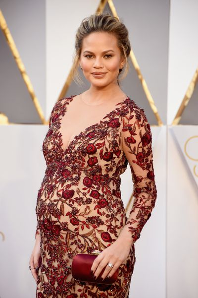 When your bump is this big there's no point in trying to hide it - and anyway, why would you want to? Chrissy is heaven in burgundy lace with a hint of cleavage.