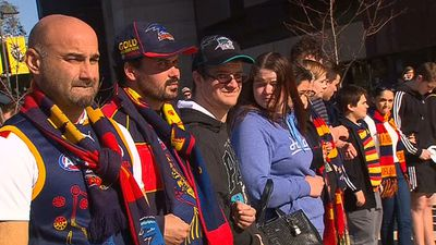 Fans stood arm in arm outside Adelaide Oval. (9NEWS)