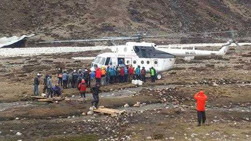 Mountaineers and Nepalese Sherpa guides evacuated from Everest Base Camp wait to board a rescue chopper to be flown to Lukla, in Pheriche, Nepal. (AP)