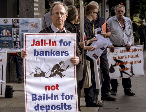 The new penalties could see dodgy bankers and finance executives face up to 10 years jail. Pictures are protesters outside the Royal Commission in Melbourne earlier this week. (AAP)