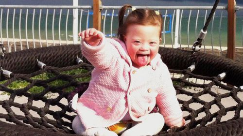 Meet the two-year-old girl with Down syndrome determined to 'kick leukaemia's butt'