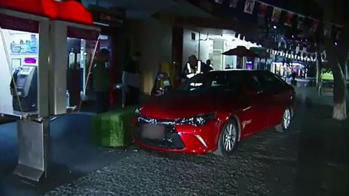 The car narrowly missed a family sitting outside a cafe. (9News)