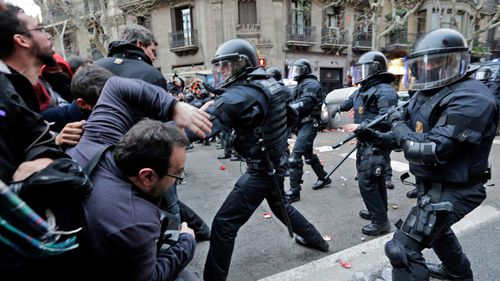 Riot police and pro-Catalan independence supporters clash in central Barcelona. (AP).