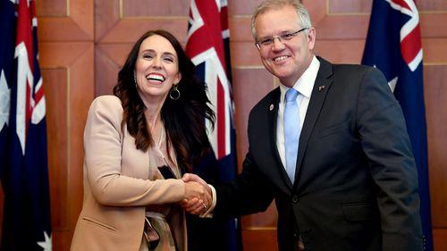 New Zealand Prime Minister Jacinda Ardern greets Australian Prime Minister Scott Morrison in Singapore.
