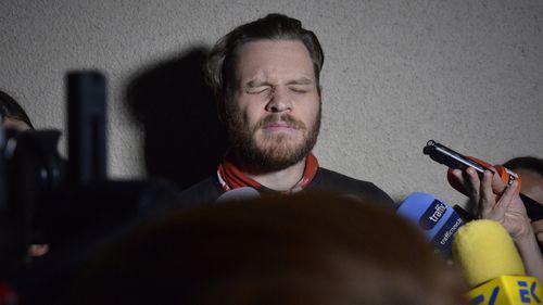 Jock Palfreeman speaks to journalists as he leaves migrants' detention centre in Busmantsi.
