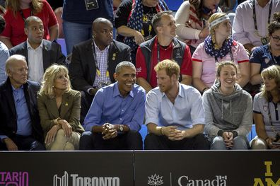 Barack Obama and Prince Harry watch wheelchair basketball at the Invictus Games in Toronto on Friday, Sept. 29, 2017.