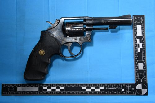 One of the handguns found by police in their investigation.