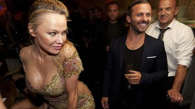 Pamela Anderson goes full mermaid, attends beach club opening soaking wet