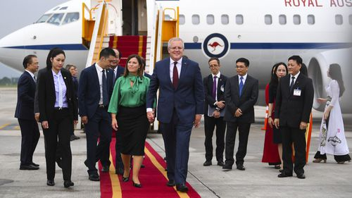 Australian Prime Minister Scott Morrison (right) and his wife Jenny are welcomed as they arrive at Noi Bai Airport in Hanoi.