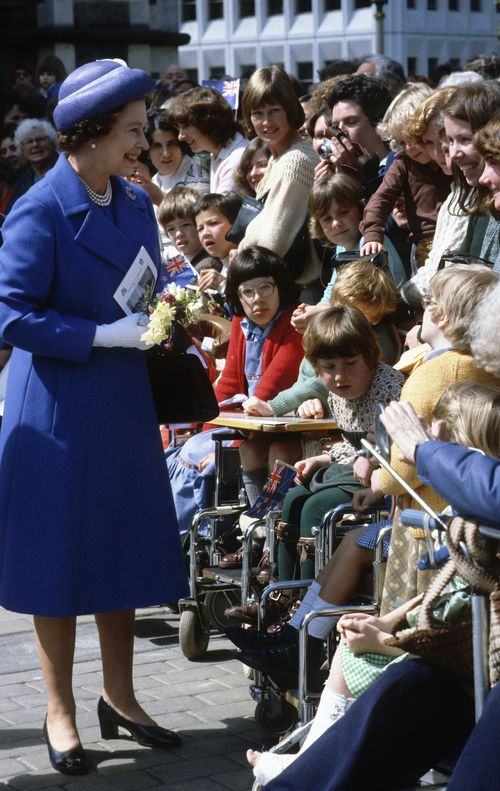 Queen Elizabeth ll smiles during a walkabout as she tours New Zealand on October 01, 1981 in New Zealand. (Photo by Anwar Hussein/Getty Images)