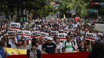 Demonstrators march to support the self-proclaimed President Juan Guaido, in Caracas.