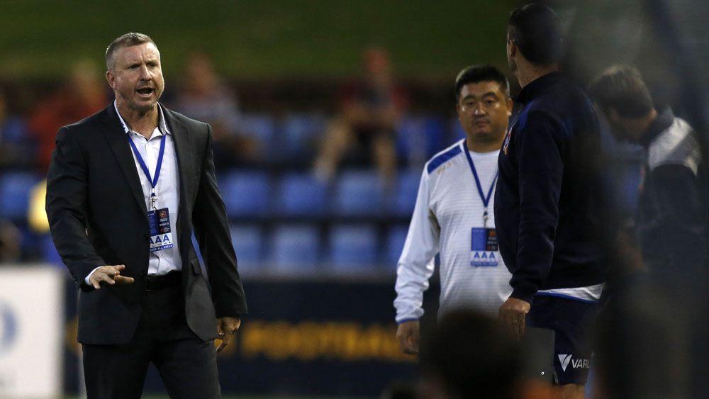 Newcastle A-League coach Mark Jones (l) was sent from the sidelines against Brisbane Roar.