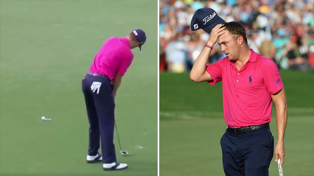 Justin Thomas reacts after his ball gets stuck on the lip during the US PGA. (AAP).