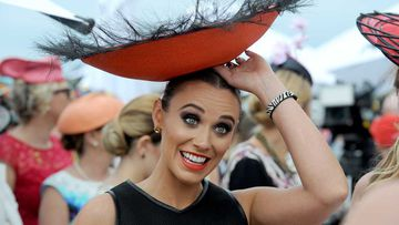 A Fashions on the Field contestant shows off her bowl-shaped hat. (AAP)