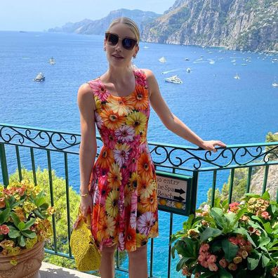 Lady Kitty Spencer poses in Positano in a bright flower patterned dress.