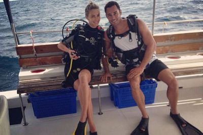 Scuba-diving on their honeymoon in The Maldives... wish you were here, babes.