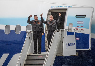 Boeing 777X chief test pilot Van Chaney, right, and co-pilot Craig Bomben, Boeing's VP Flight operations and chief test pilot, emerge from the 777X after landing at Boeing Field in Seattle, following its first flight on Saturday, Jan. 25, 2020.