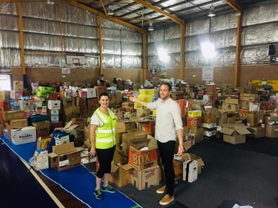 Tim Davies and Michelle Babington Ulladulla Civic Centre Manager at the Milton showground basketball court, which is chock-full of donations