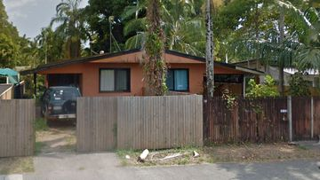 A man is fighting for life after allegedly being stabbed by a woman in a Cairns home.
