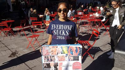 <p>Americans have bought or made their own stickers, shirts and posters to make political statements. </p> <p>(9news.com.au / Ehsan Knopf)</p>