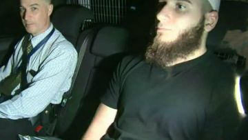Agim Kruezi in police custody. Picture: 9NEWS