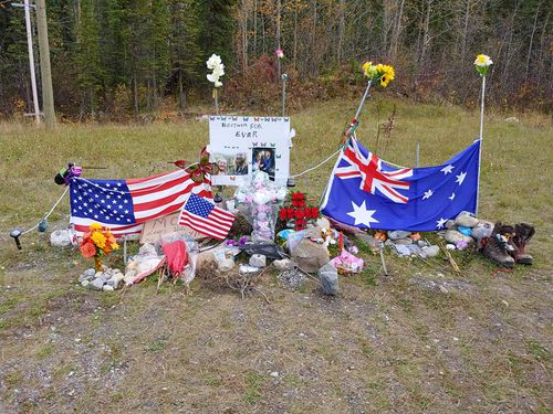 The memorial has quickly grown, with many travellers leaving behind gifts and mementos. Ed Grennan and John Van Vyfeyken are constructing a permanent shelter to house and protect the shrine, including wooden crosses and flag poles for the Australian and US flags.