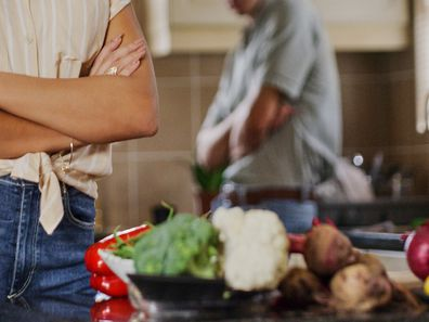 Couple fighting in kitchen food on bench