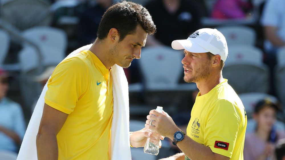 Bernard Tomic (l) and Lleyton Hewitt. (AAP)