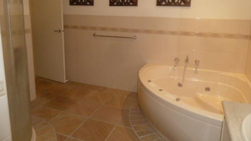 Images of the home uploaded online show a lavish bathroom.