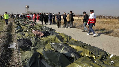 Bodies of the victims of a Ukrainian plane crash are collected by rescue team at the scene of the crash in Shahedshahr, southwest of the capital Tehran, Iran.