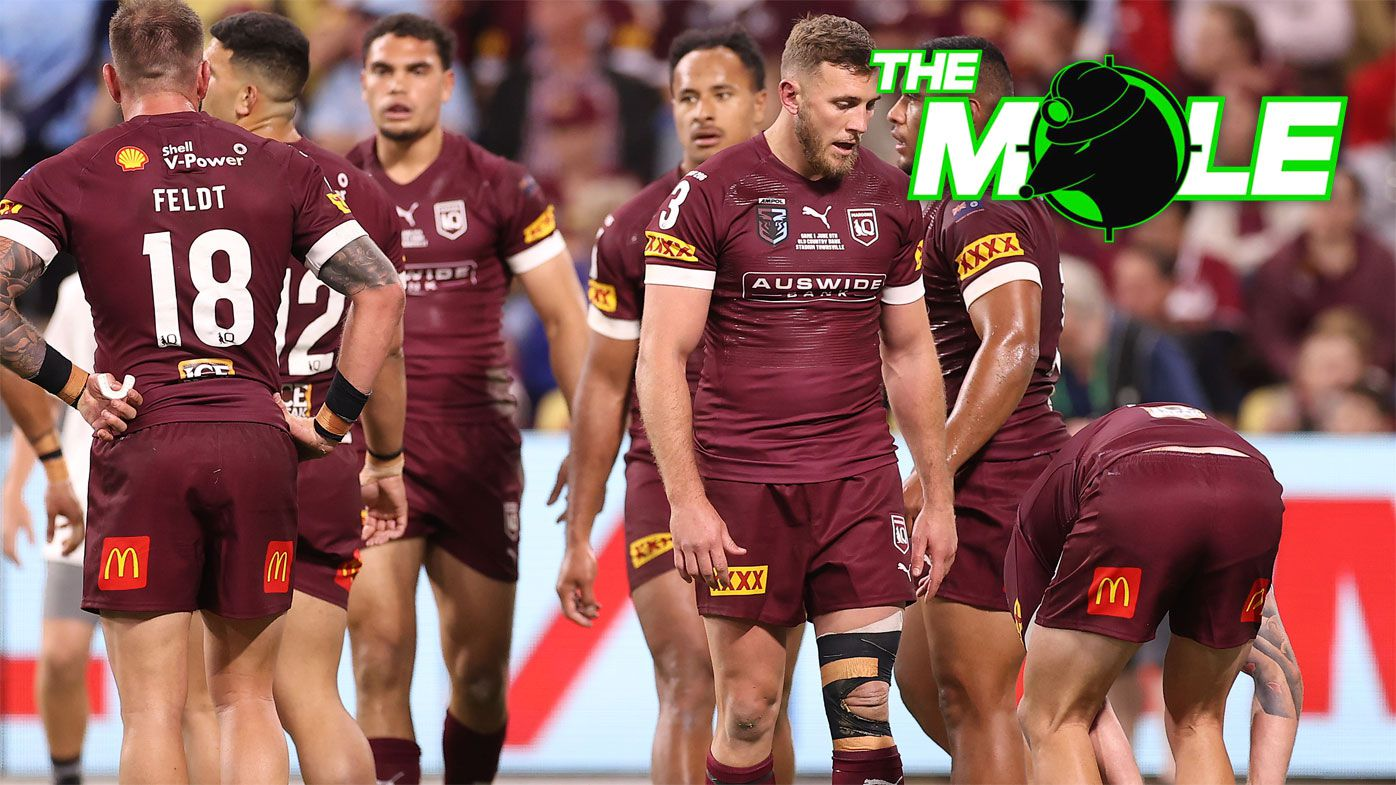 Queensland players react after conceding a try.