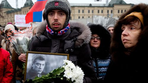 Protesters march against the death of Boris Nemtsov. (AAP)