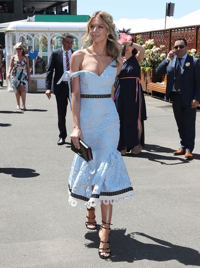 <p>Hit: This was Jennifer Hawkins' best racewear look all week. The teasing off-the shoulder neckline of the Talulah dress, fitted skirt with a playful flare and soft powder blue fabric were a style trifecta. With her hair gathered softly beneath a Natalie Bikicki headpiece, Hawkins holds her crown as the queen of the track.</p> <p>Miss: Top form. No room for improvement.</p>