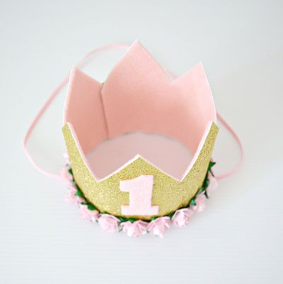 """<a href=""""https://www.etsy.com/au/listing/279834192/1st-birthday-pink-flower-mini-crown-baby?ref=shop_home_active_13"""" target=""""_blank"""">Little Miss Charlie 1st Birthday Crown, $32.50.</a>"""