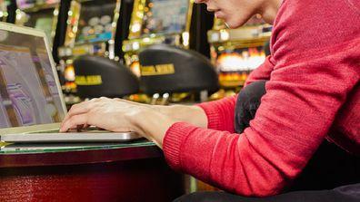 Man using his computer at a casino