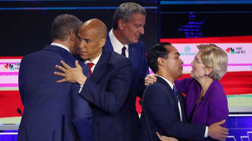 Tim Cory hugs Cory Booker, while Julian Castro embraces Elizabeth Warren at the end of the debate. Bill De Blasio is seen not touching anyone.