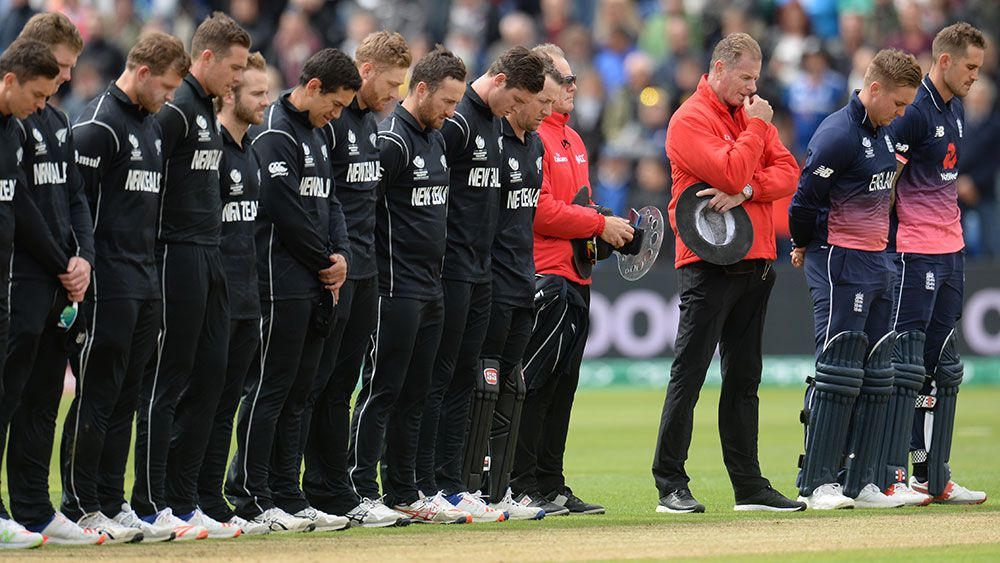 New Zealand and England cricketers observe a minute's silence. (Getty)