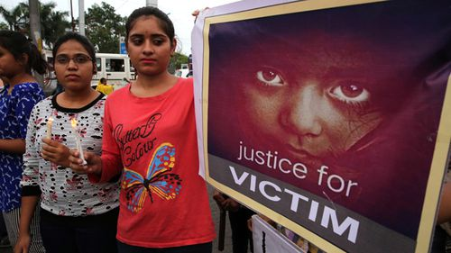 Indian people hold posters and candles during a candle light march to protest against the rape of a seven-year-old girl in Mandsaur, in Bhopal, India, 01 July 2018. The protest was held over the brutal rape of a seven-year-old girl who is undergoing treatment in a hospital.