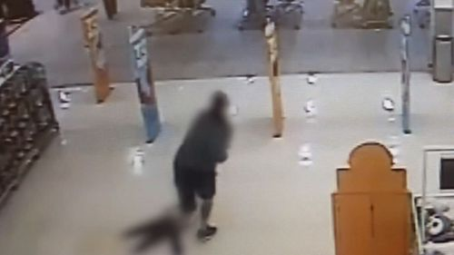 In CCTV vision from a Big W store at the Nambour Plaza shoping centre, the man can be seen dragging the four-year-old girl along the ground. Picture: Supplied.
