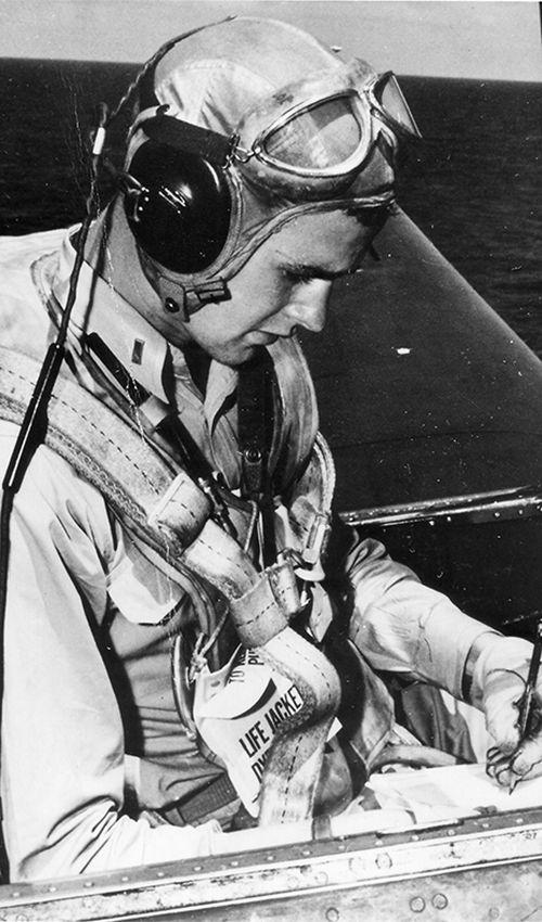 George HW Bush in the cockpit of an Avenger.