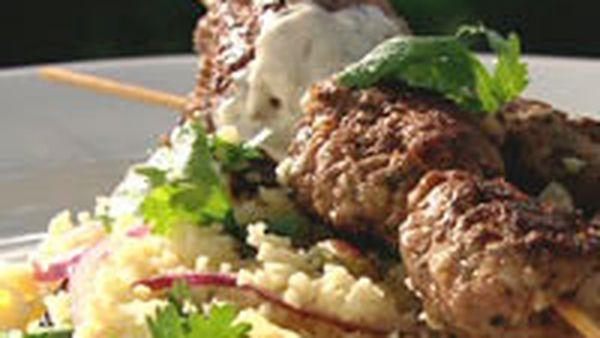 Bbq lamb koftas with spicy yoghurt and couscous salad