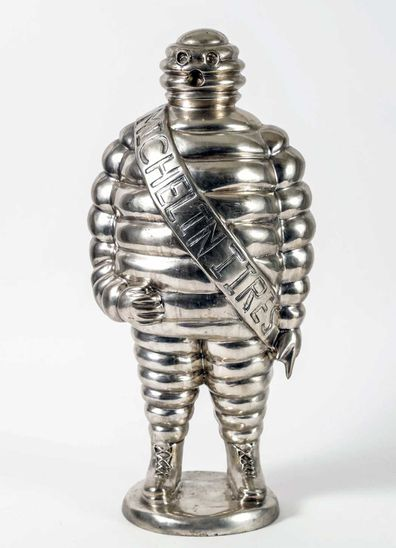 A silver and bronze sculpture of the Michelin man that was owned by Anthony Bourdain